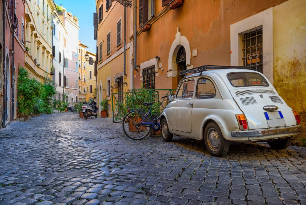 Car parked on cozy street in Italy.