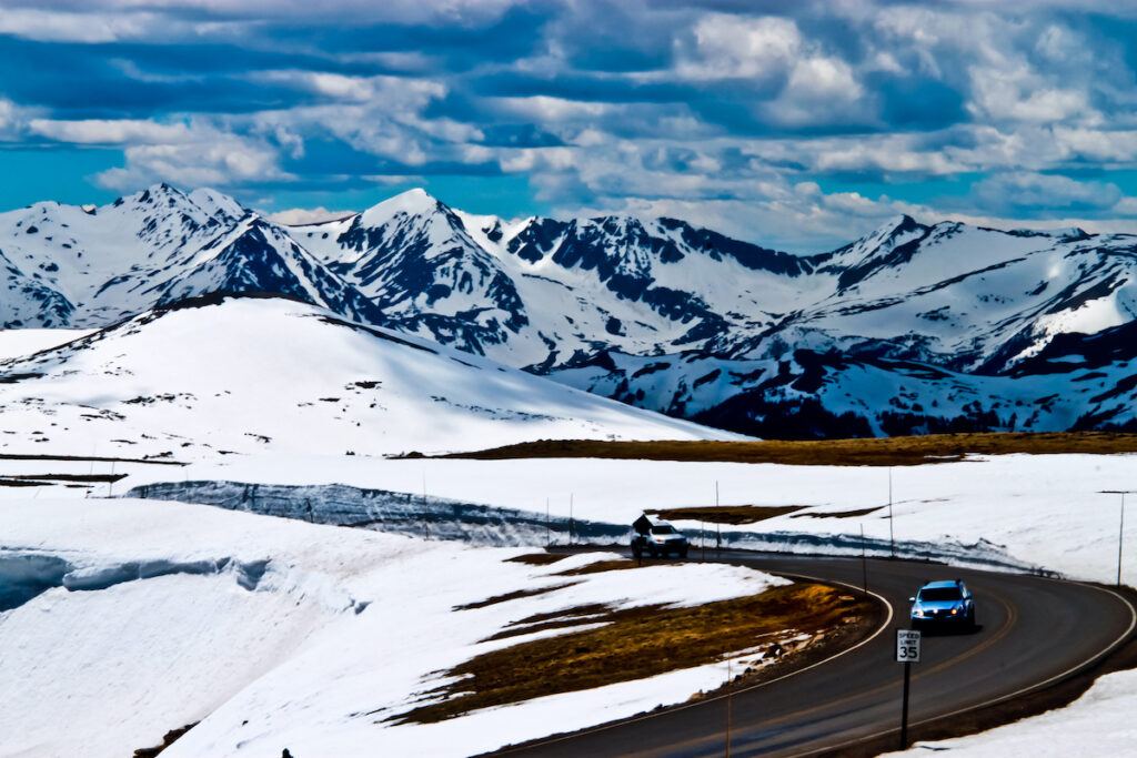 Cars on Trail Ridge Road in the snow.