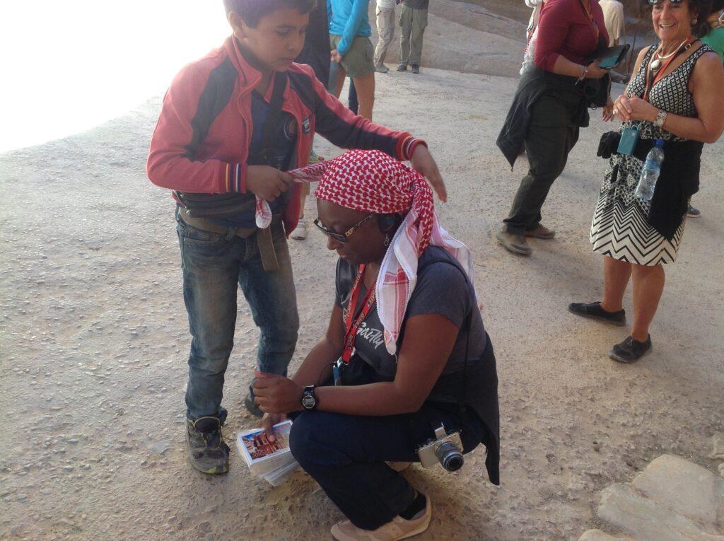 Cassandra Washington trying on a traditional Jordanian headscarf