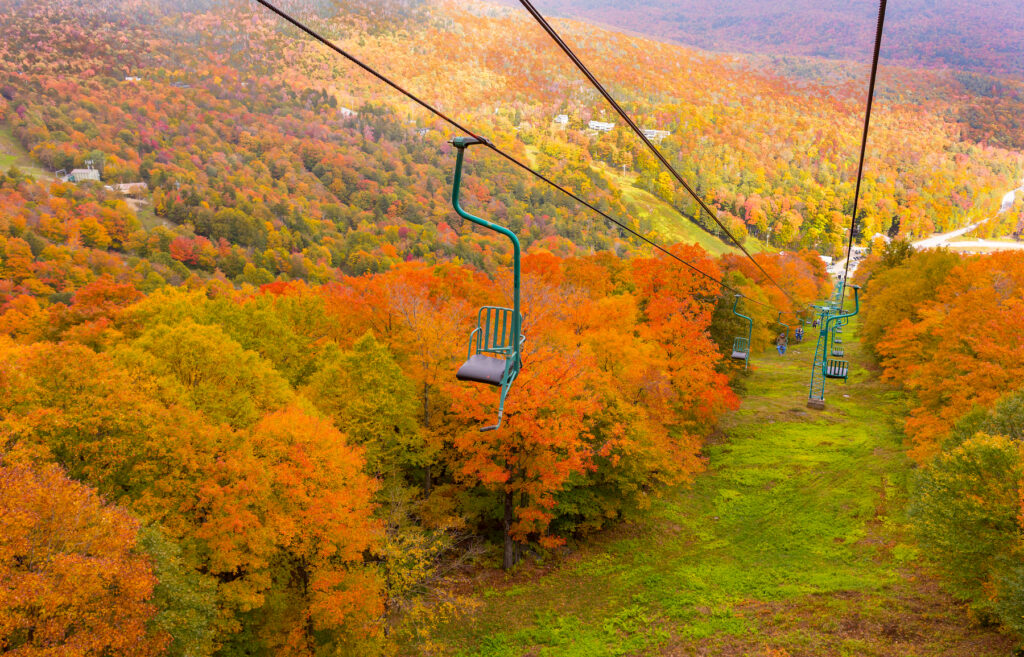 Chairlift over fall foliage in the Mad River Valley.