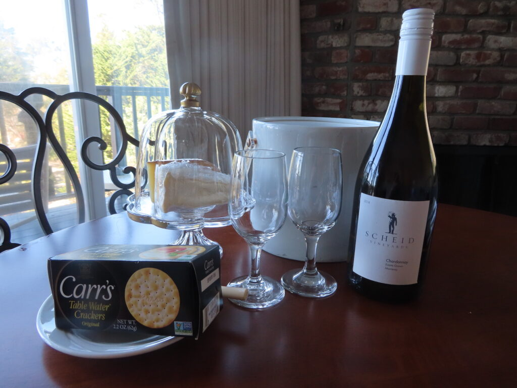 Cheese, crackers, and wine at Hofsas House Hotel.