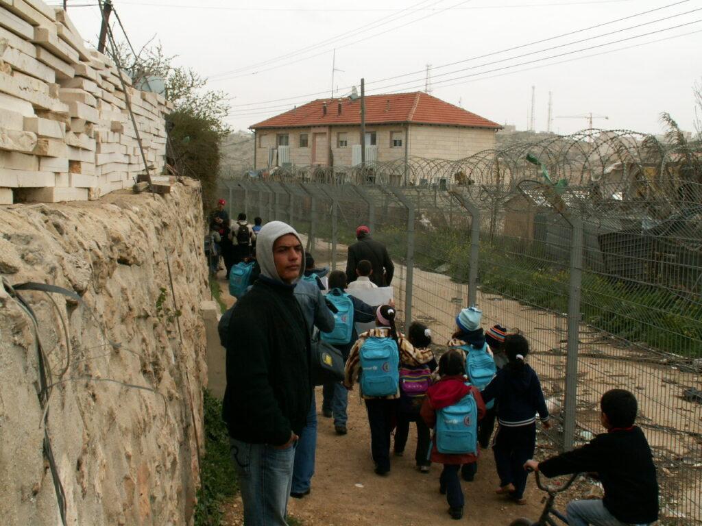 Children in Israel being escorted to school.