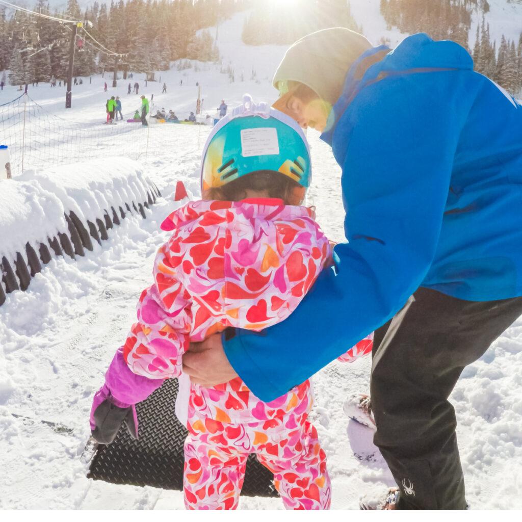 Children learning how to ski at Arapahoe Basin Ski Area.