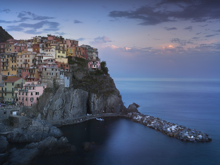 Cinque Terre, Italy, village on cliff looks out over the sea at dusk