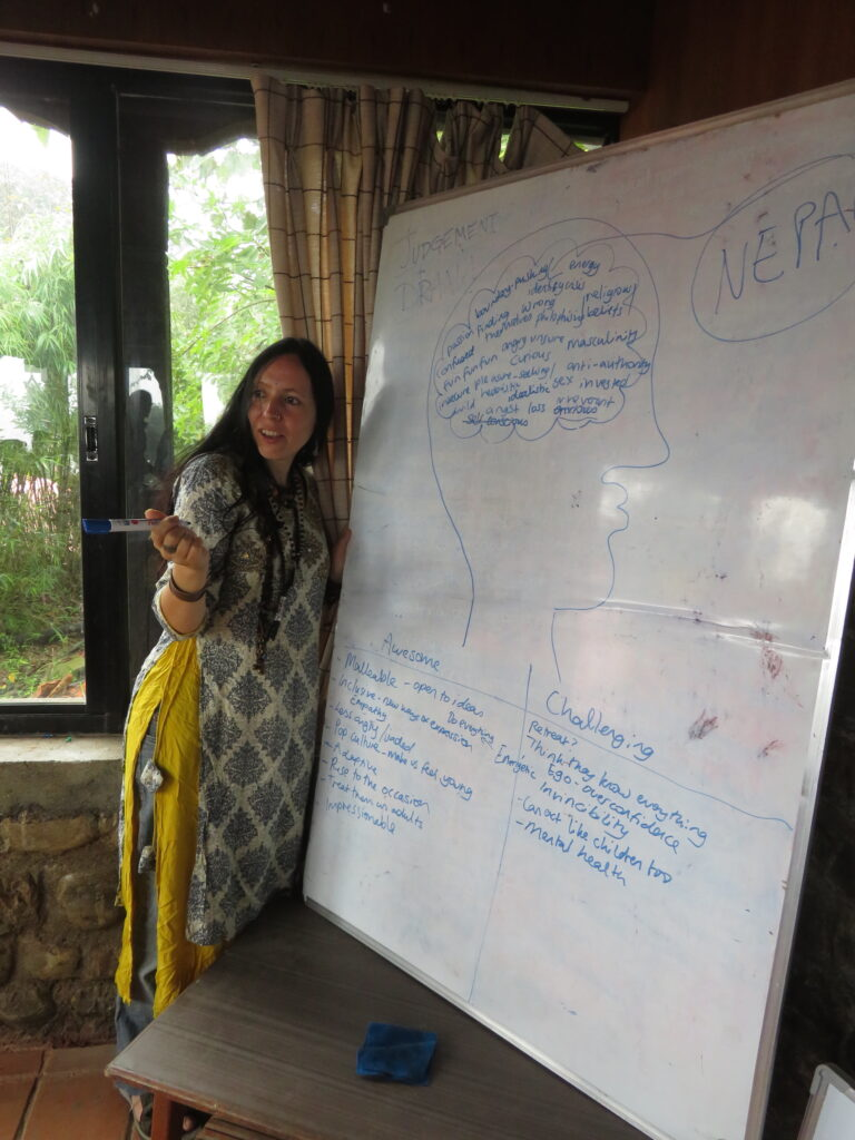 Claire Bennett teaching about Learning Service in Nepal.