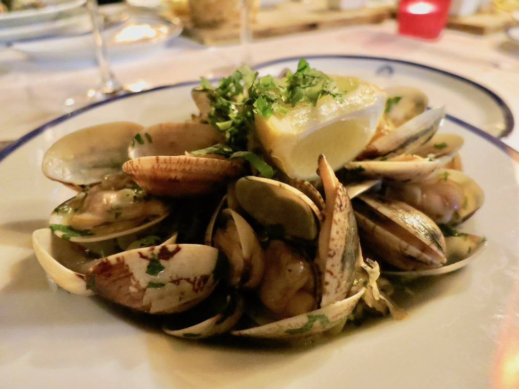 Clams smothered in butter and garlic in Portugal.