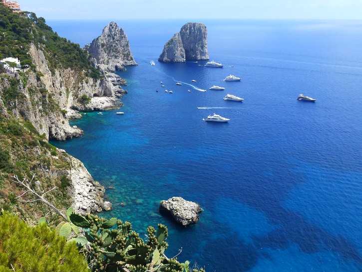 Cliffs of Capri, Italy, with yachts off the coast.