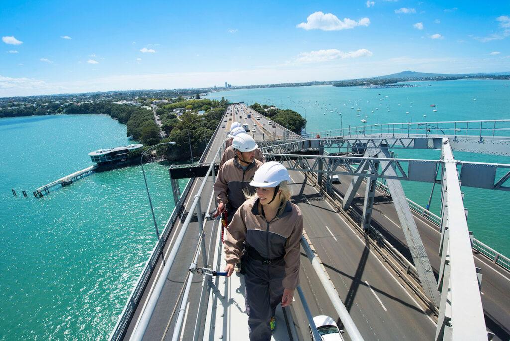 Climbing Auckland Harbour Bridge, New Zealand.