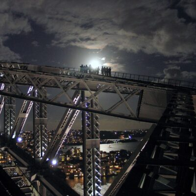 Climbing the Sydney Harbour Bridge at night.