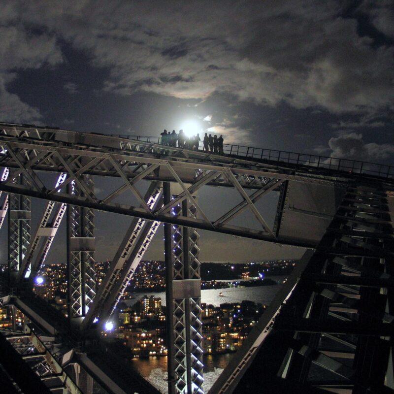 Climbing the Sydney Harbour Bridge at night.