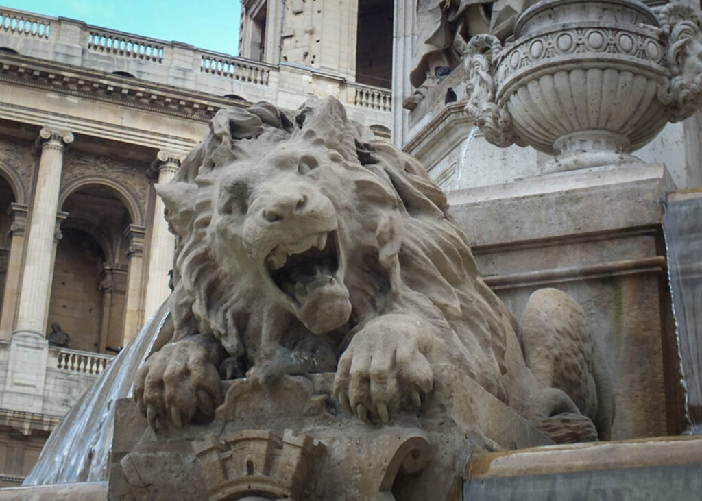 Close-up of a lion on the fountain outside Saint Sulpice.