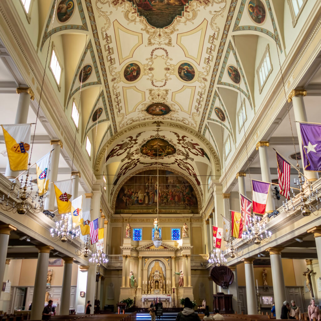 Colorful flags flying in the nave of St. Louis Cathedral in New Orleans