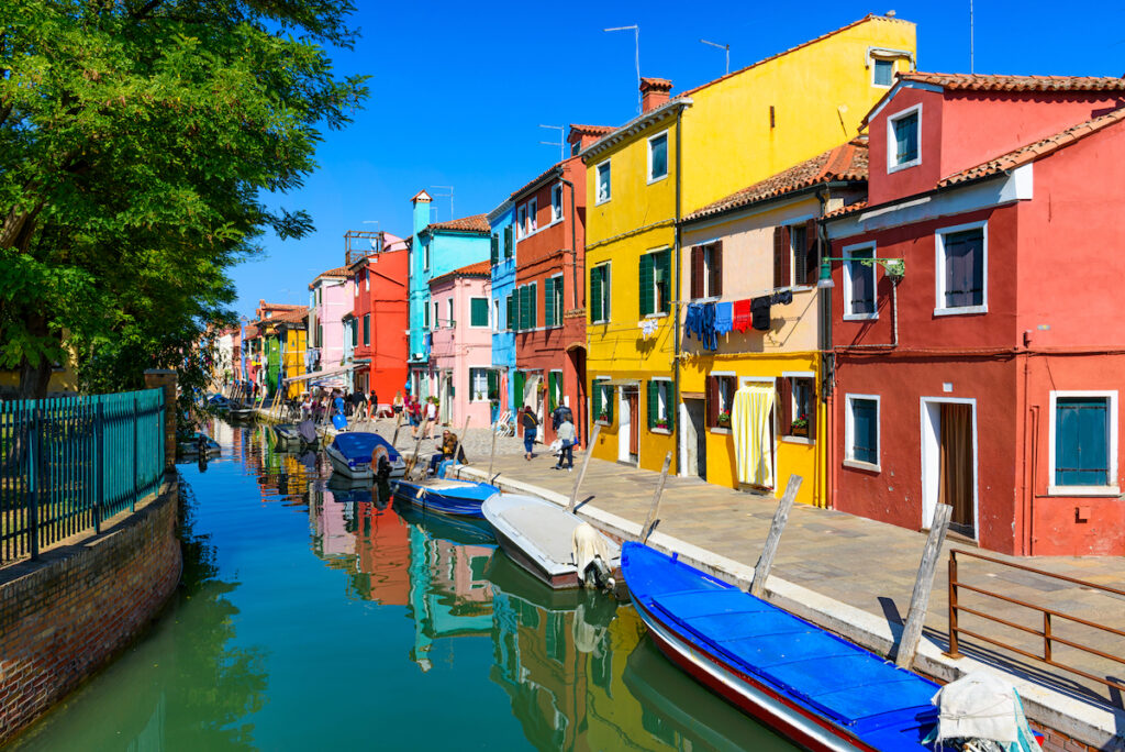 Colorful houses along a canal in Burano, Italy.