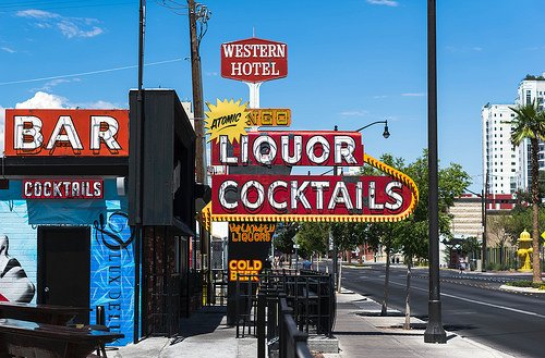 Colorful signs outside a Vegas liquor and cocktail shop