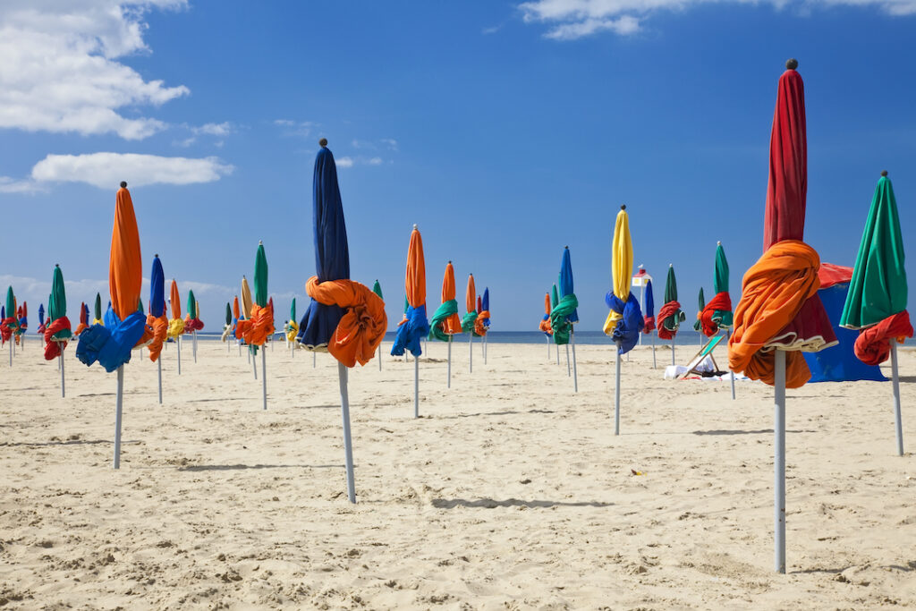 Colorful umbrellas on famous Deauville Beach