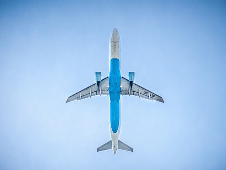 Commercial airliner flying overhead, seen from directly underneath