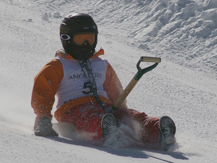 Competitive shovel racing.