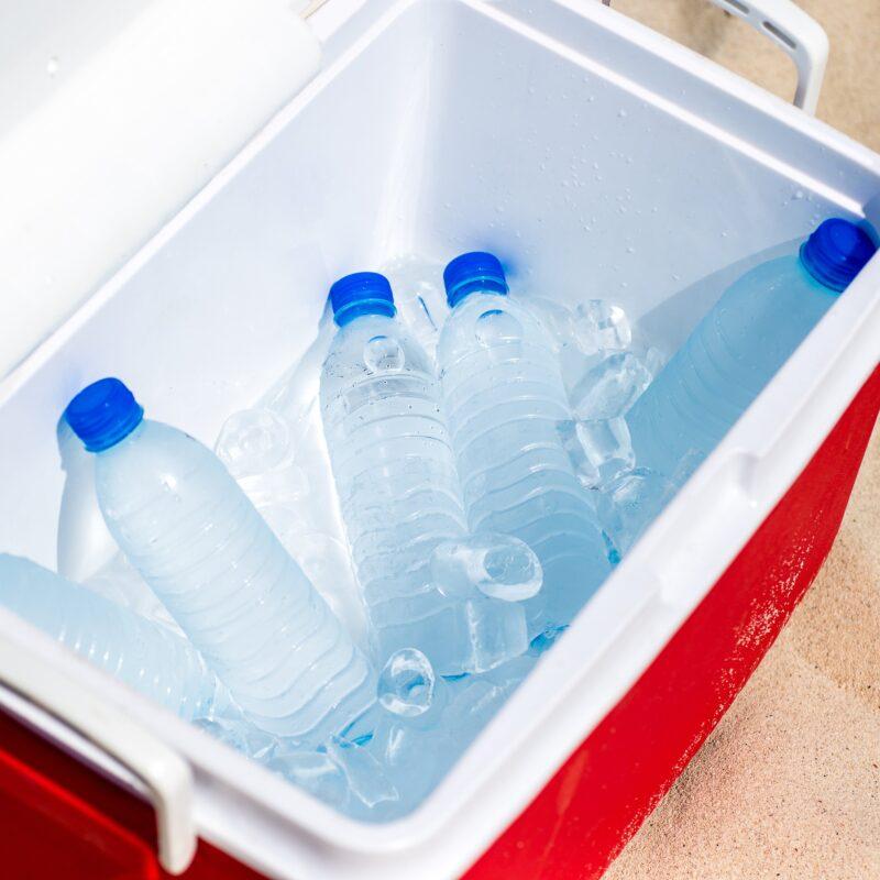 cooler full of water bottles