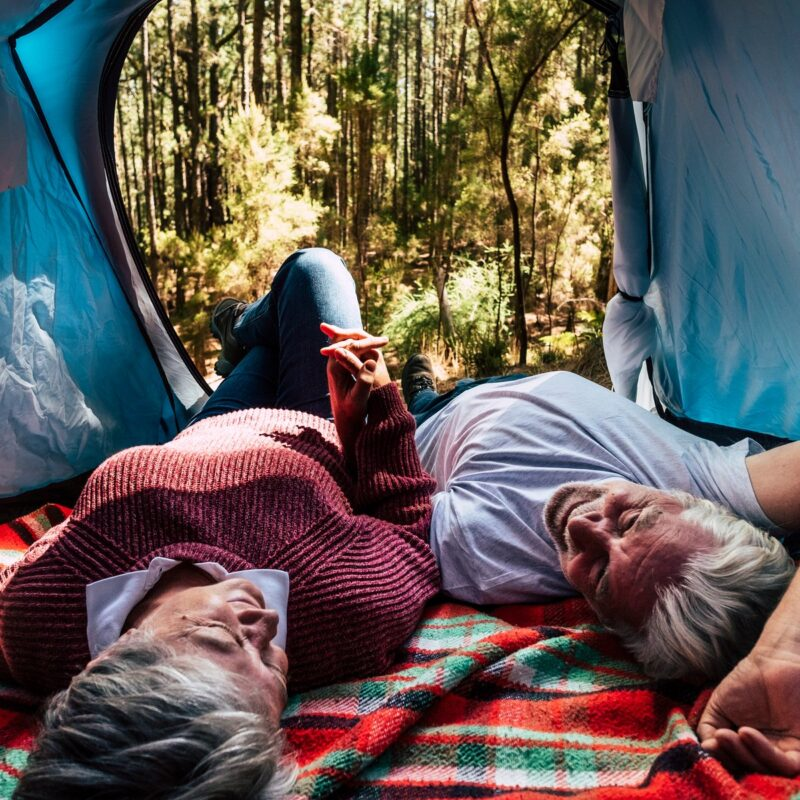 Couple free camping in the wild.