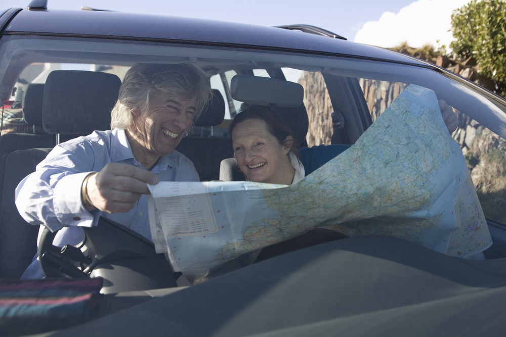 couple using a map to navigate