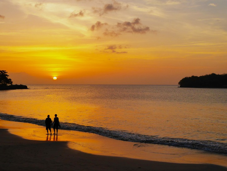 Couple walking on the beach at sunset in St. Lucia