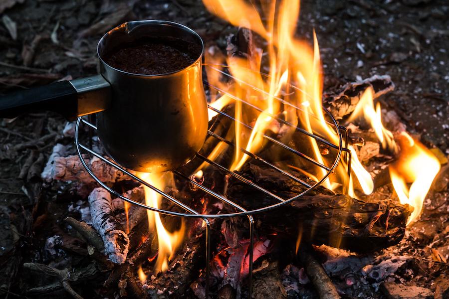 Cowboy coffee over a bonfire.