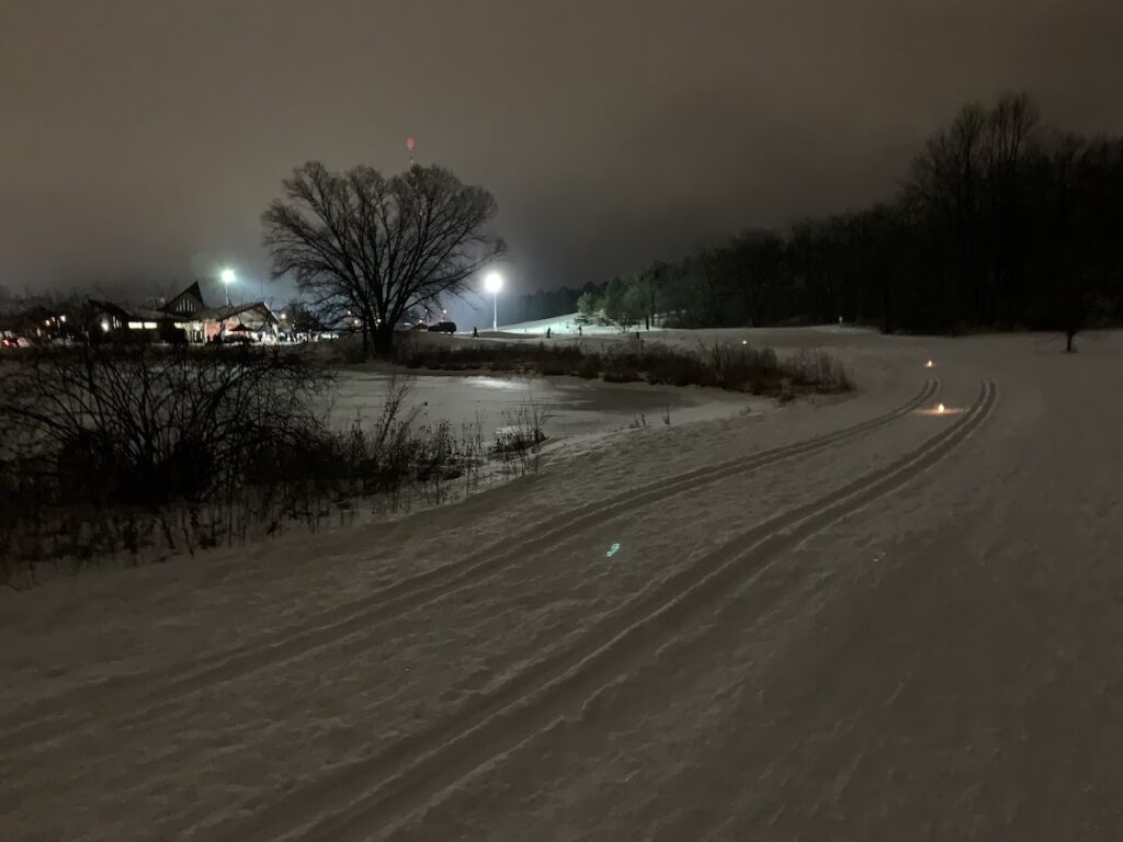 Cross-country skiing by candle light in the Midwest.