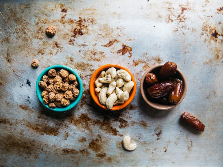 Cups of nuts and dried dates