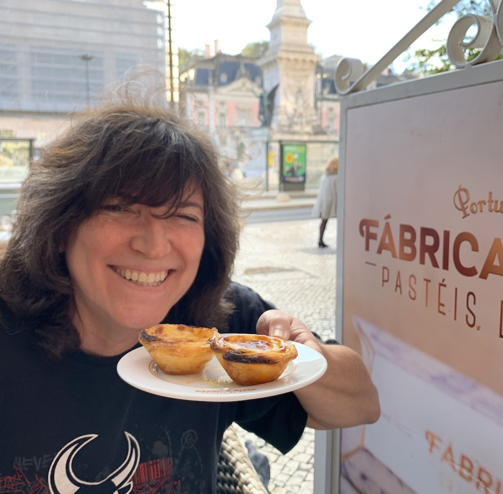 Diana with Pasteis de Nata in Portugal.