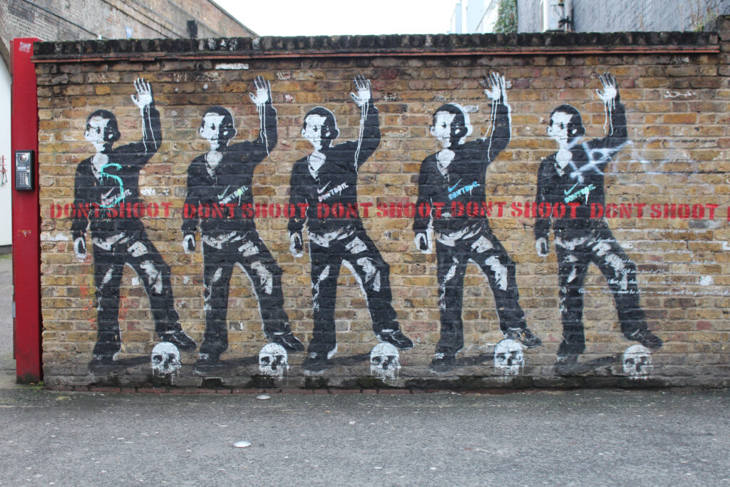 Don't Shoot street art by artist Bambi on Rivington in Shoreditch, London