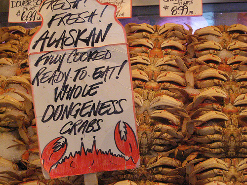Dungeness crab with sign