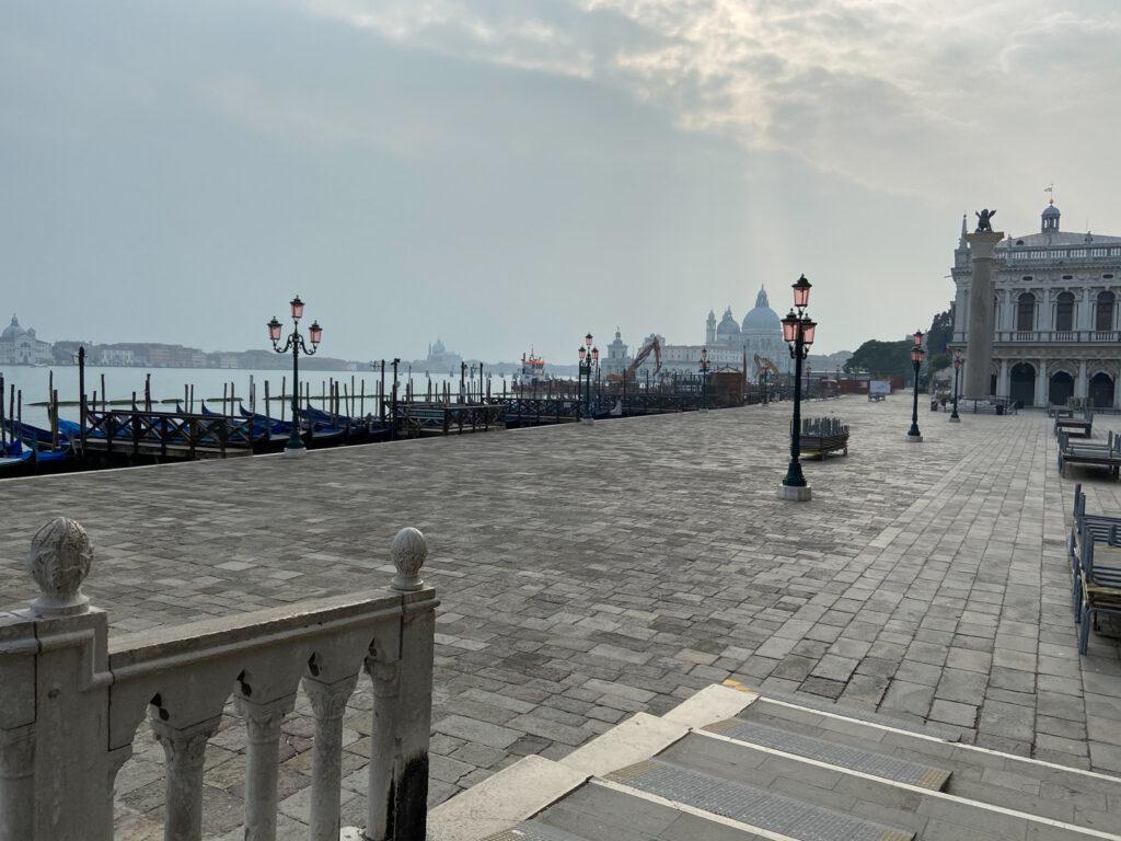 Empty sidewalks and gondolas in Venice.