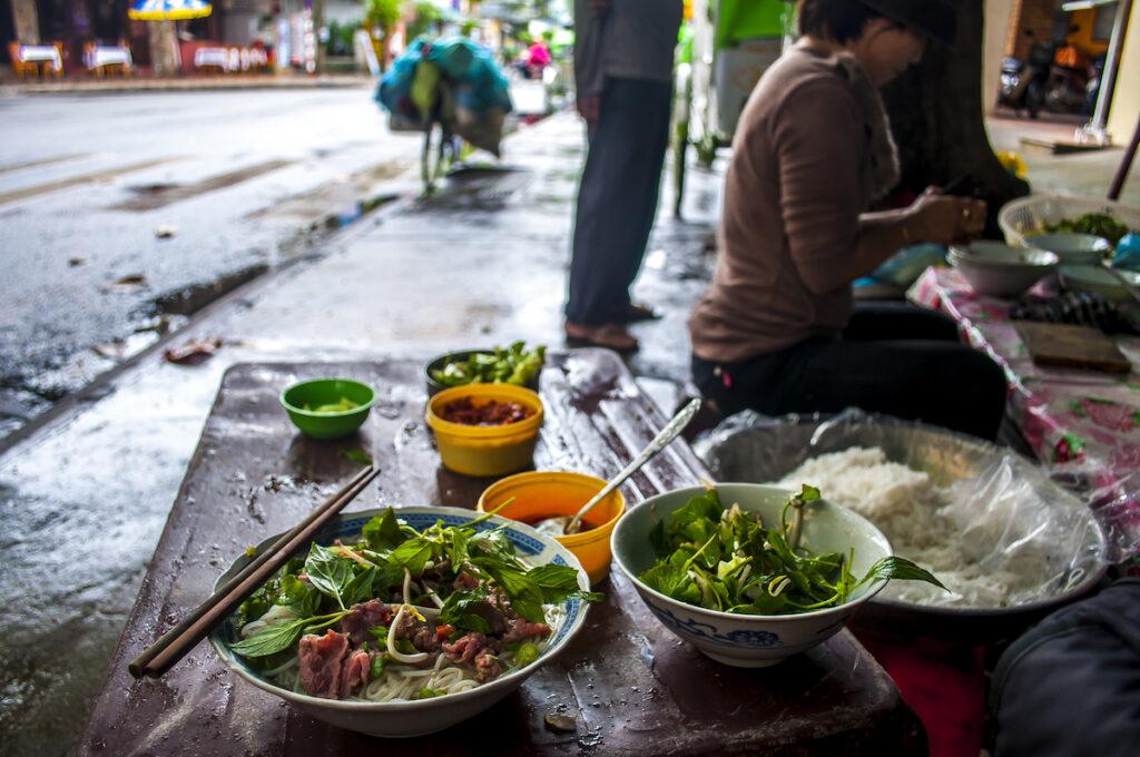 Enjoying pho in Hanoi, Vietnam.