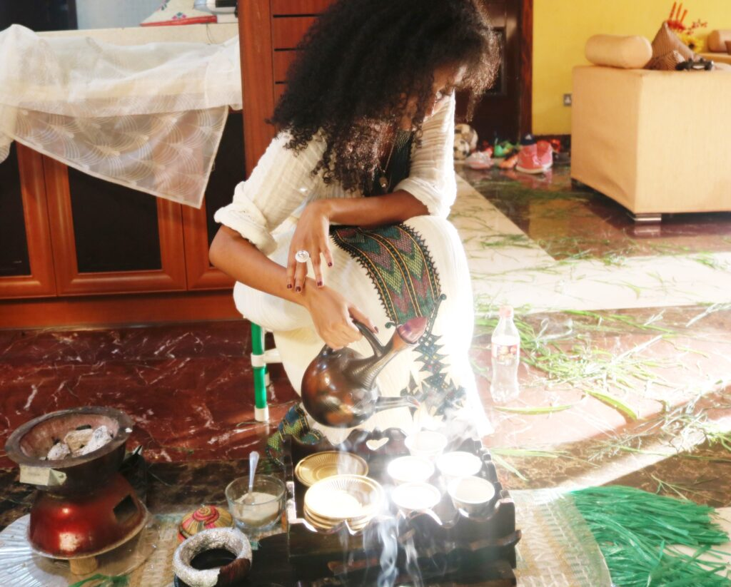 Ethiopian woman pouring coffee