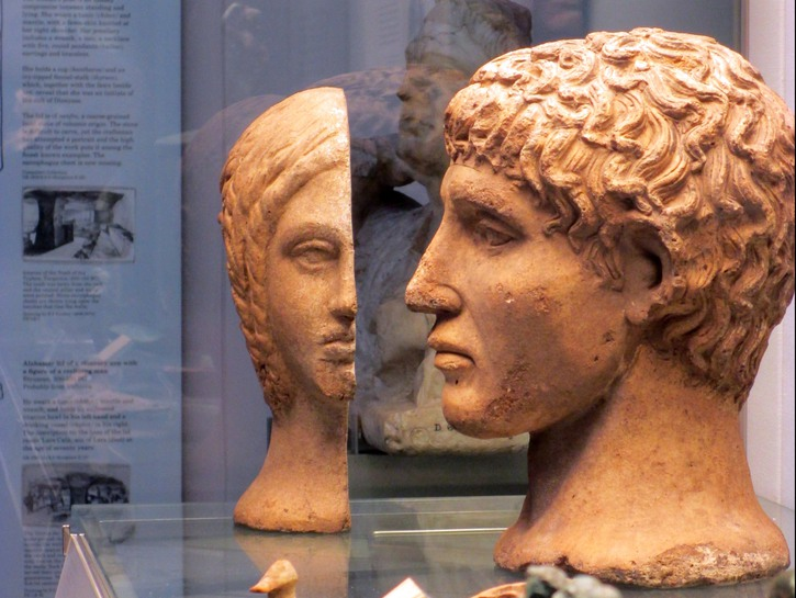 Etruscan sculpture remains behind glass