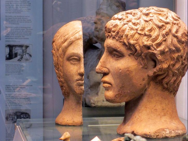 Etruscan sculpture remains behind glass