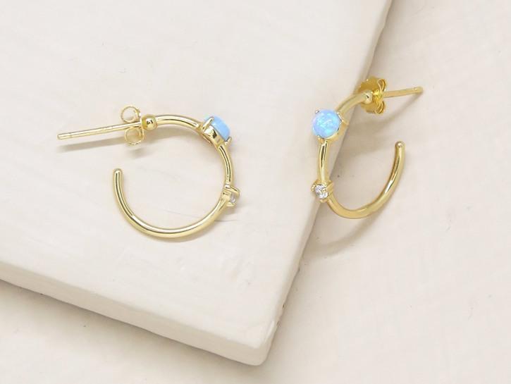 Ettika small gold hoop earrings with blue gemstones