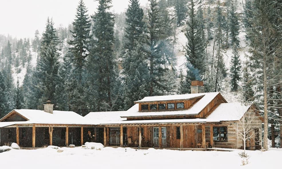 Exterior view of snowy Taylor River Lodge in Almont.