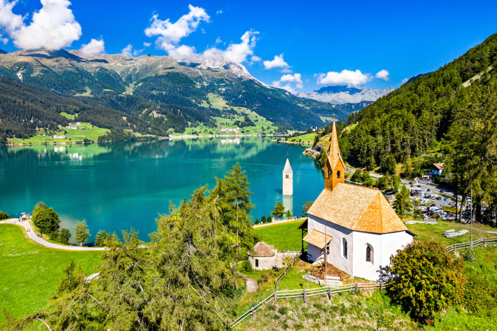 Faraway view, bell tower in Lake Resia.