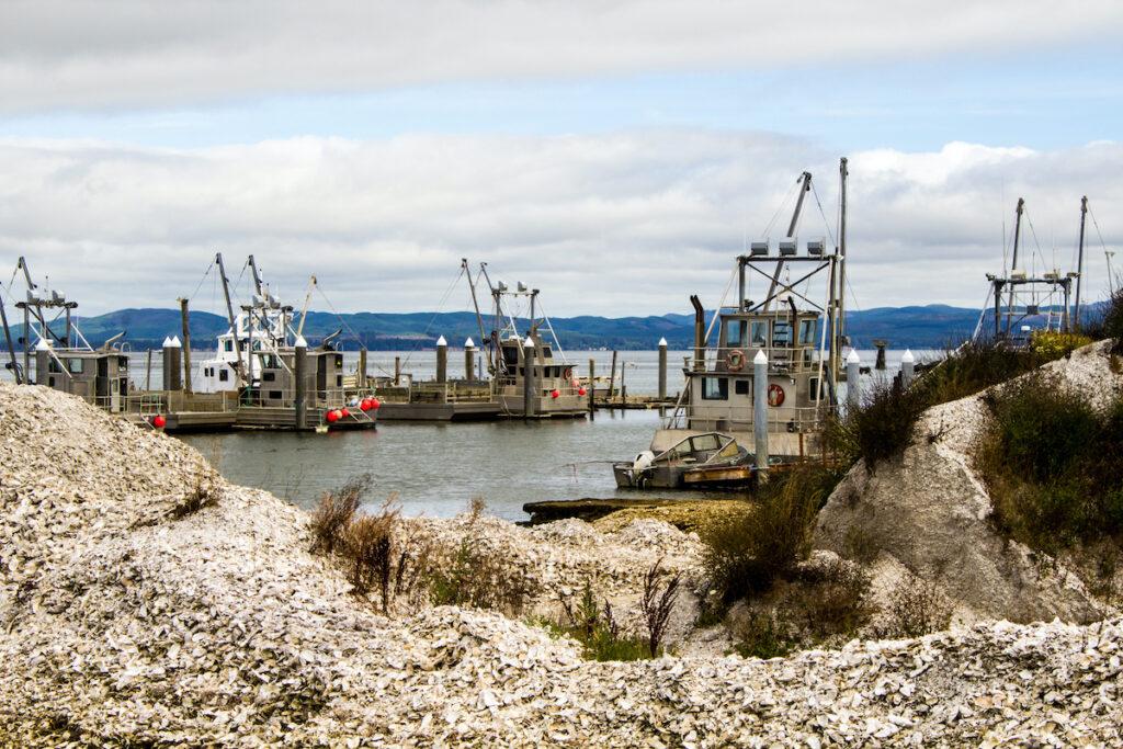 Fishing boats, oyster shells, Oysterville, Washington.