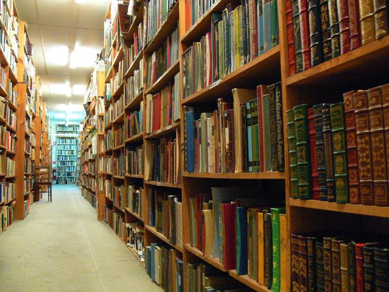 Floor-to-ceiling bookshelves at Archives Fine Books in Brisbane