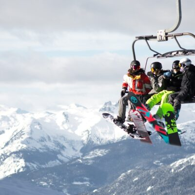 four snowboarders on ski lift
