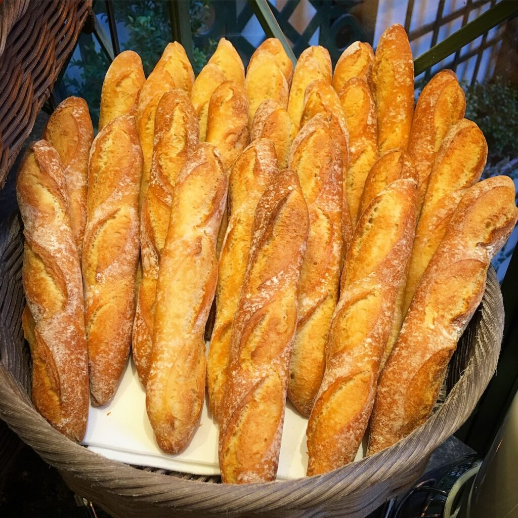 Fresh baguettes in a basket.
