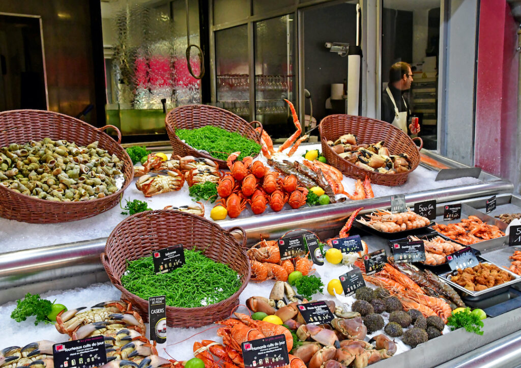 Fresh seafood displayed on ice and in baskets in Trouville, France