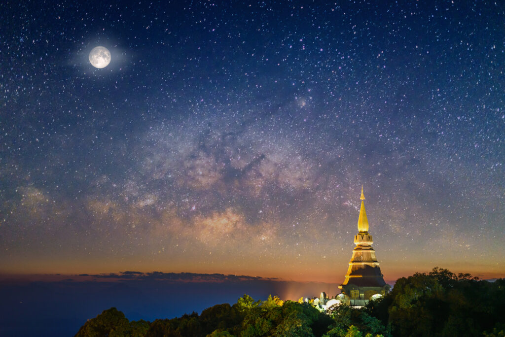 Full moon and starry sky over a pagoda in Chiang Mai, Thailand