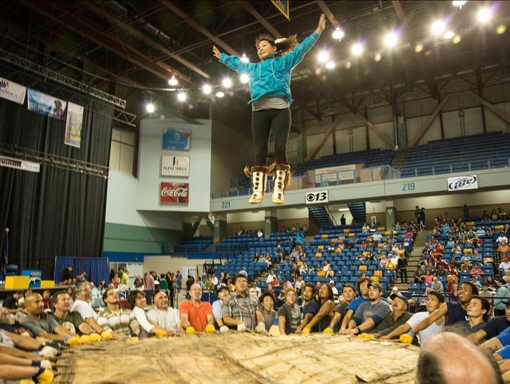 Girl jumping on hide, the blanket toss, Eskimo-Indian Games, Fairbanks Alaska