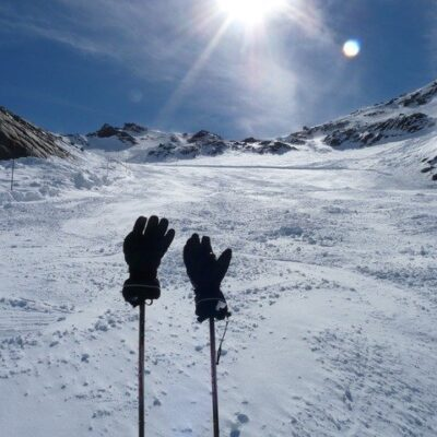 gloves on ski poles on a mountain