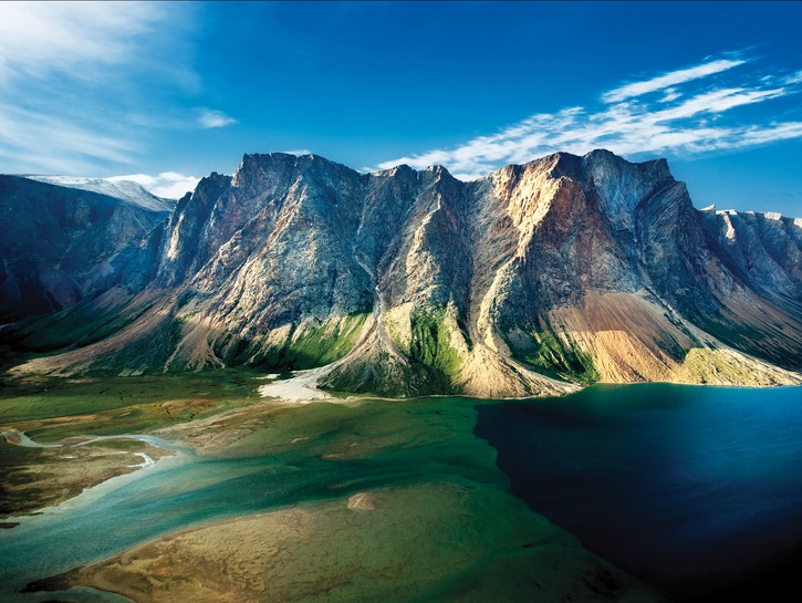 Green and blue lake with mountains rising on the shore, Torngat Mountains National Park, Canada