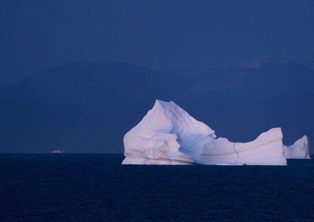 Greenland icebergs at dusk.