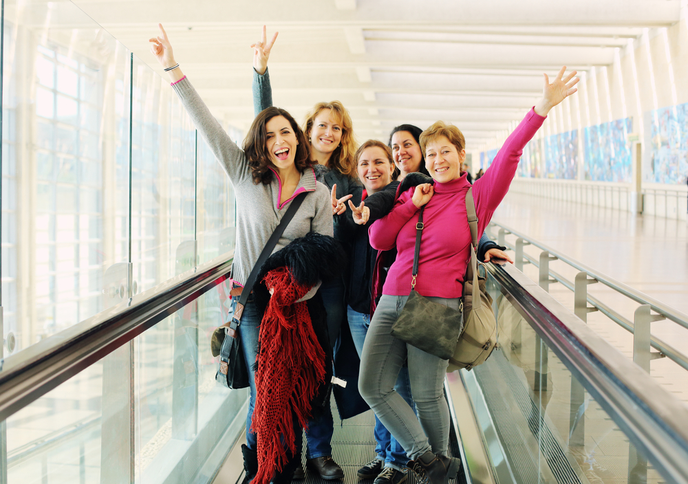 group of women traveling in an airport